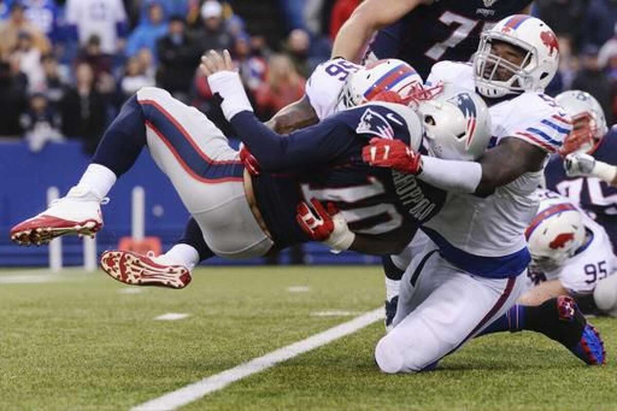 Buffalo Bills inside linebacker Zach Brown (53) sacks New England Patriots' Jimmy Garoppolo (10) during the second half of an NFL football game Sunday, Oct. 30, 2016, in Orchard Park, N.Y. The Patriots win 41-25. (AP Photo/Adrian Kraus)