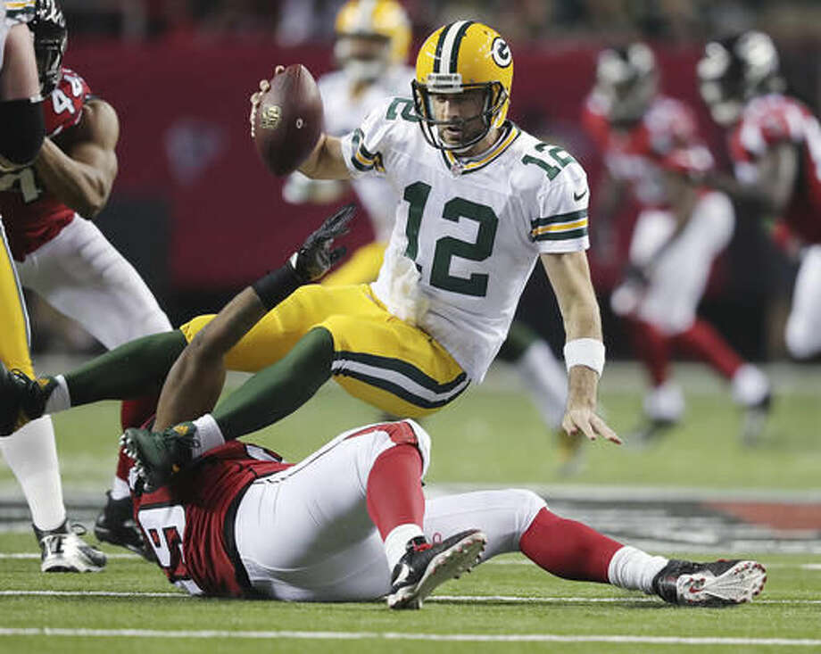 Atlanta Falcons defensive end Adrian Clayborn sacks Green Bay Packers quarterback Aaron Rodgers during the third quarter in an NFL football game on Sunday, Oct. 30, 2016, in Atlanta. (Curtis Compton/Atlanta-Journal Constitution via AP)