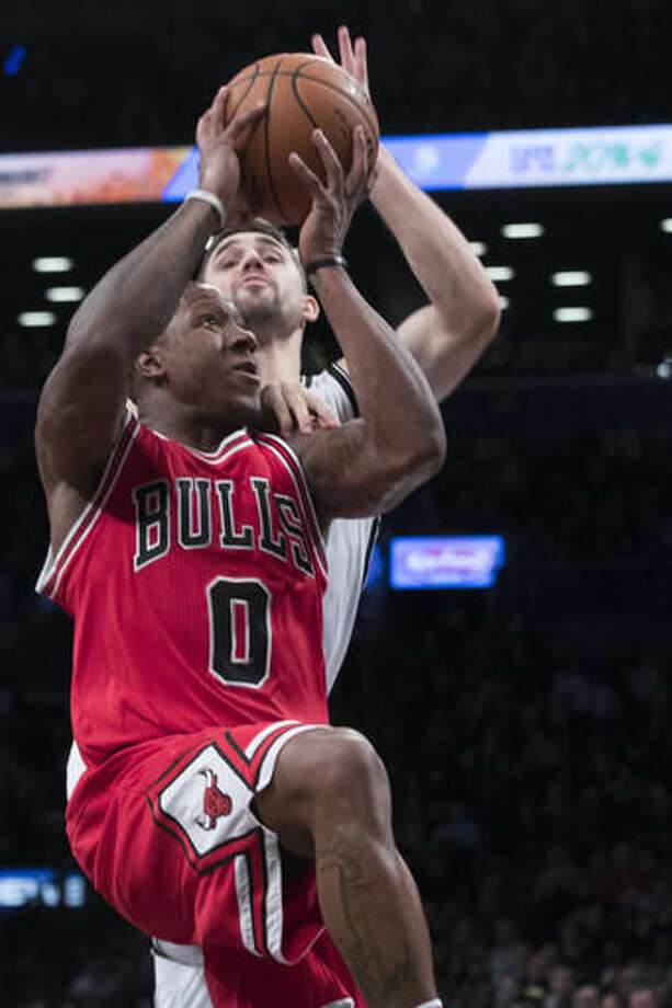 Chicago Bulls guard Isaiah Canaan (0) goes to the basket against Brooklyn Nets guard Joe Harris during the first half of an NBA basketball game, Monday, Oct. 31, 2016, in New York. (AP Photo/Mary Altaffer)`