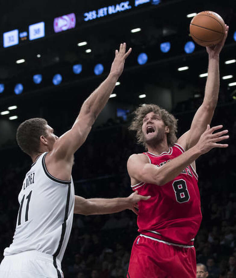 Chicago Bulls center Robin Lopez (8) goes to the basket against Brooklyn Nets center Brook Lopez (11) during the first half of an NBA basketball game, Monday, Oct. 31, 2016, in New York. (AP Photo/Mary Altaffer)