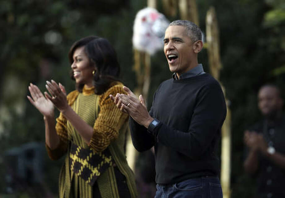 "President Barack Obama and the first lady Michelle Obama applaud as they watch performance of a bunch of kids dancing to the beat of the "" Thriller"" during a trick-or-treat celebrating Halloween at the South Portico of the White House in Washington, Monday, Oct. 31, 2016. (AP Photo/Manuel Balce Ceneta)"