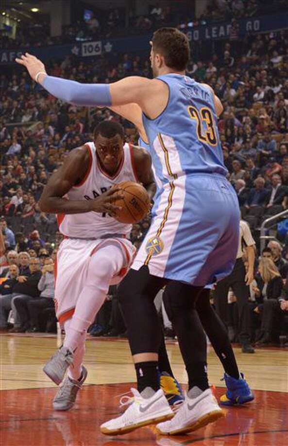 Toronto Raptors' Pascal Siakam, left, drives to the net against Denver Nuggets' Jusuf Nurkic during the first half of their NBA basketball game in Toronto on Monday, Oct. 31, 2016. (Jon Blacker/The Canadian Press via AP)