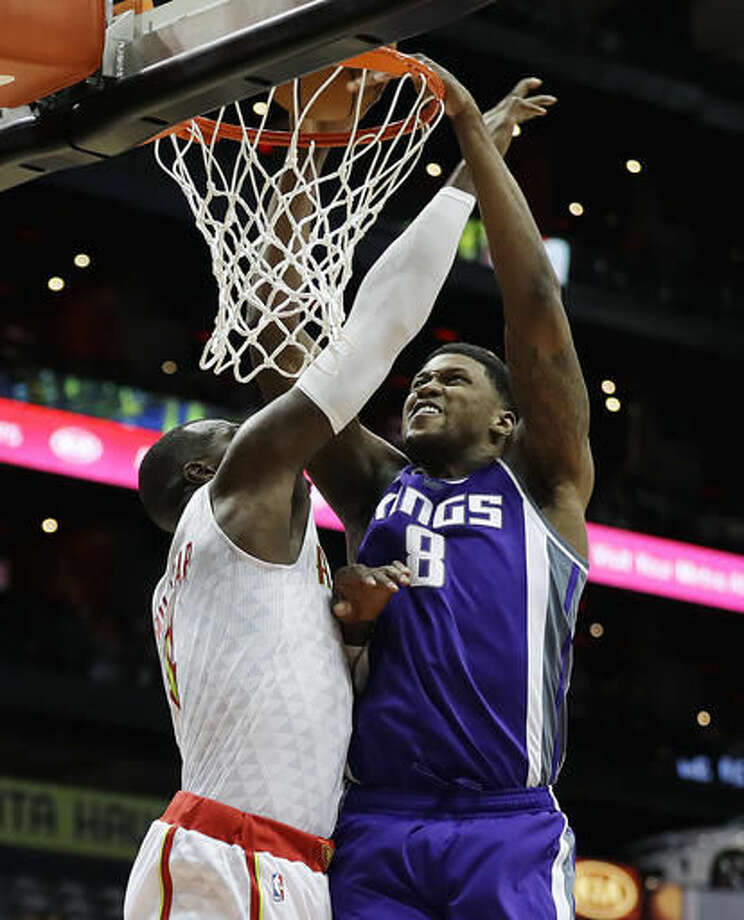 Sacramento Kings' Rudy Gay, right, dunks the ball against Atlanta Hawks' Paul Millsap in the third quarter of an NBA basketball game in Atlanta, Monday, Oct. 31, 2016. (AP Photo/David Goldman)