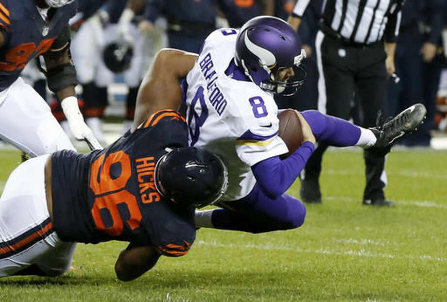 Chicago Bears defensive end Akiem Hicks (96) sacks Minnesota Vikings quarterback Sam Bradford (8) during the first half of an NFL football game in Chicago, Monday, Oct. 31, 2016. (AP Photo/Charles Rex Arbogast)