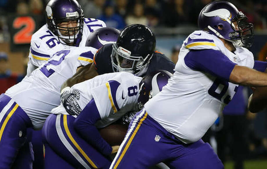 Chicago Bears outside linebacker Leonard Floyd (94) sacks Minnesota Vikings quarterback Sam Bradford (8) during the first half of an NFL football game in Chicago, Monday, Oct. 31, 2016. (AP Photo/Nam Y. Huh)