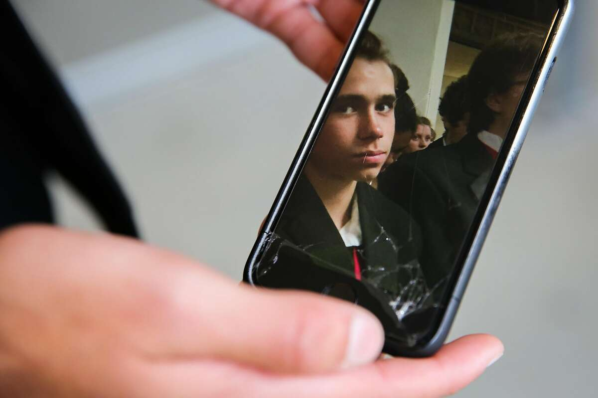 Student Gabriel Bibliowicz,18, shows a photo of friend Draven McGill, 17, who was killed in the Ghost Ship fire in San Francisco, California, on Monday, Dec. 5, 2016.