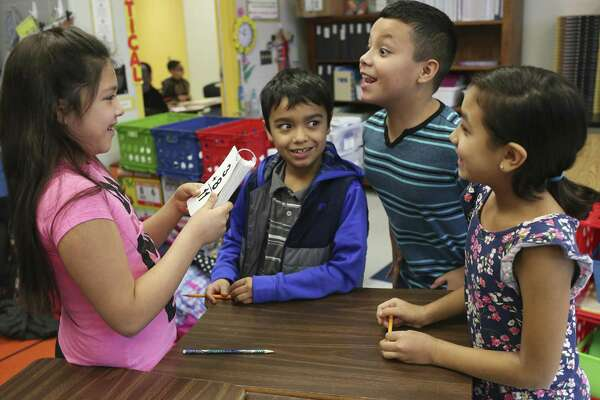 "Makayla Valdez, 9, left, quizzes from left, Frank Muniz, 8, Shawn Perez, 9, and Sydney Castillo, 8, during a third grade math class at Harlandale Independent School District's Wright Elementary School, Tuesday, Nov. 15, 2016. Principal Martha Gonzalez and Academic Coordinator Victoria Trevino took over the school two years ago and the school has gone from a Texas Education Agency ""improvement required"" school -- meeting only 2 out of 14 performance rate indicators -- to achieving a ""met standard"" rating with all six TEA distinctions and meeting all indexes of student performance."