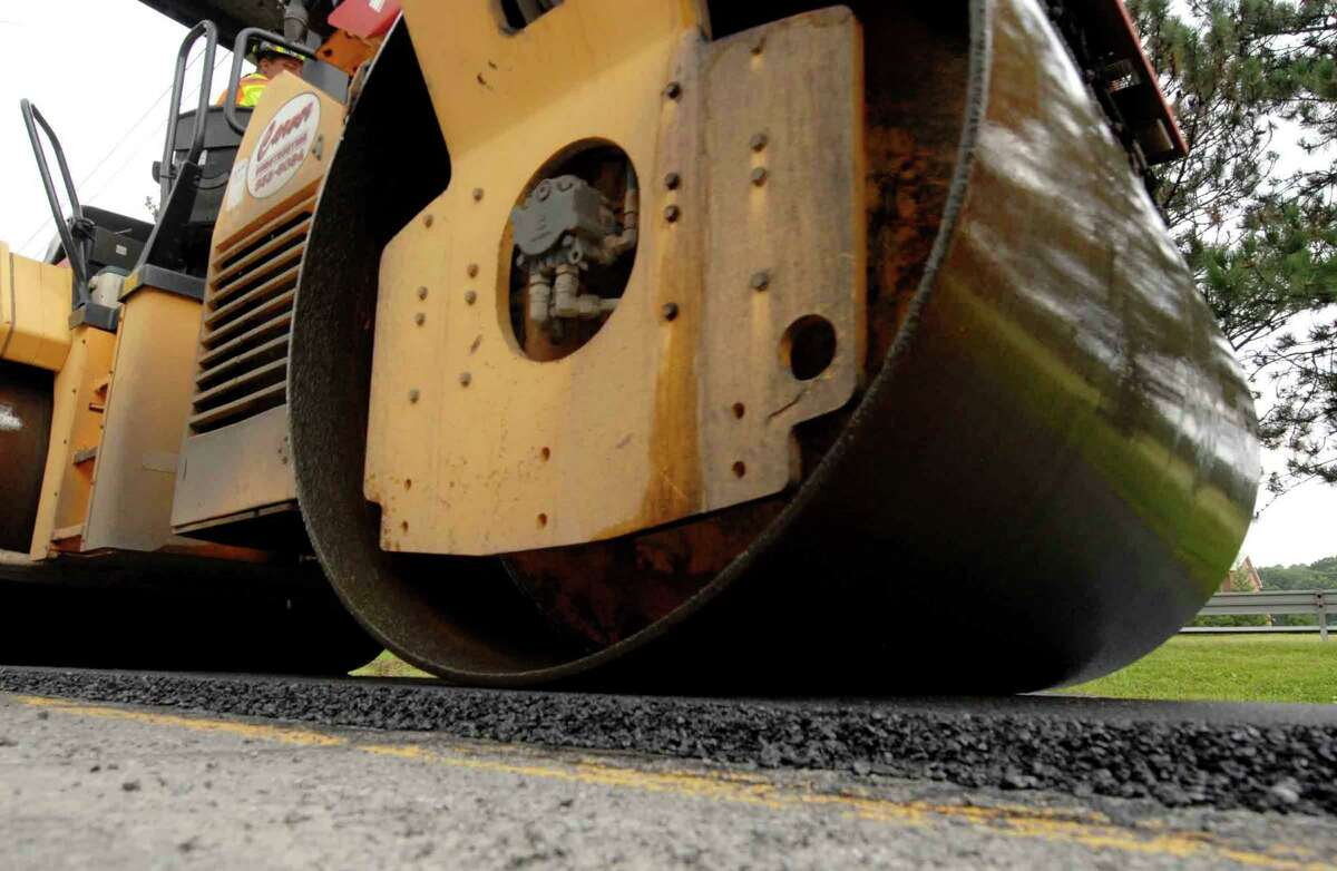 Crews work on paving a 1.7-mile portion of Old Niskayuna Road with a new environmentally sound