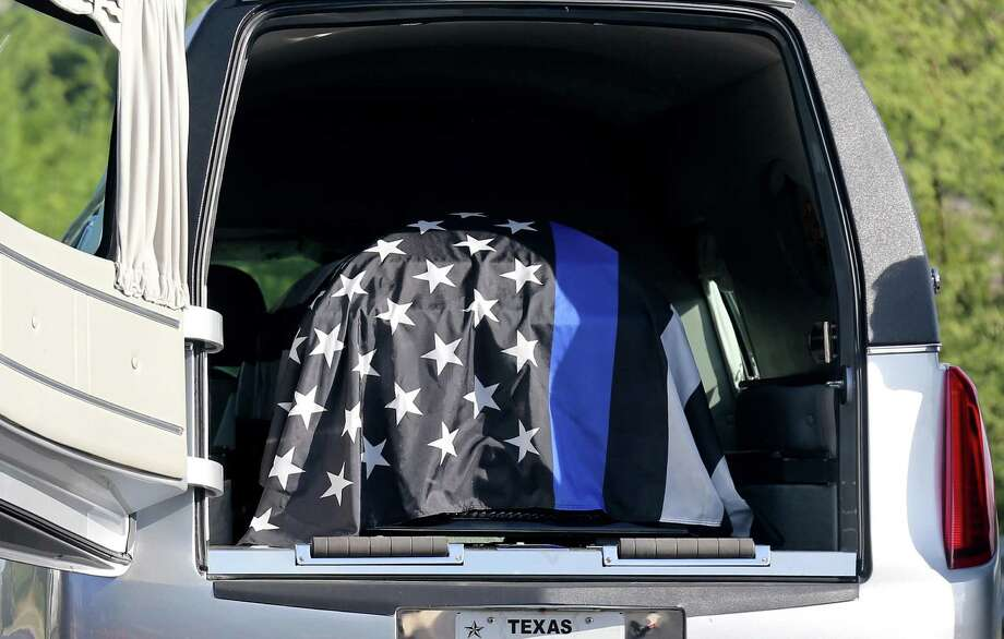 The flag draped casket of San Antonio Police Department Detective Benjamin Marconi, who was killed outside police headquarters last week, is seen in the hearse before being transferred to a horse-drawn carriage during the funeral held Monday Nov. 28, 2016 at Community Bible Church. Photo: Edward A. Ornelas, Staff / San Antonio Express-News / © 2016 San Antonio Express-News