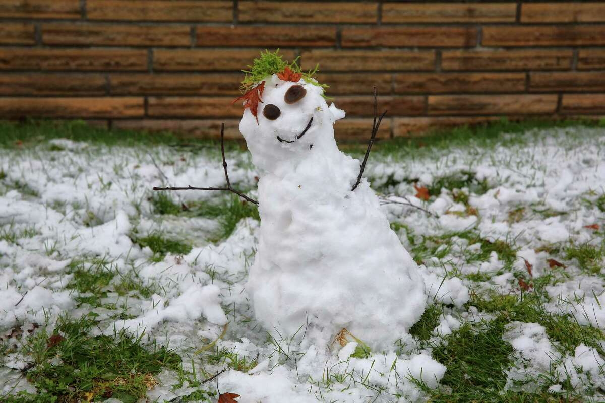 A small snowman made by Malino Schlegel, 2, sits in the front yard of of his house in south Rainier Beach, Monday, Dec. 5, 2016. Areas of King County over 400 feet saw some snow fall early Monday morning.
