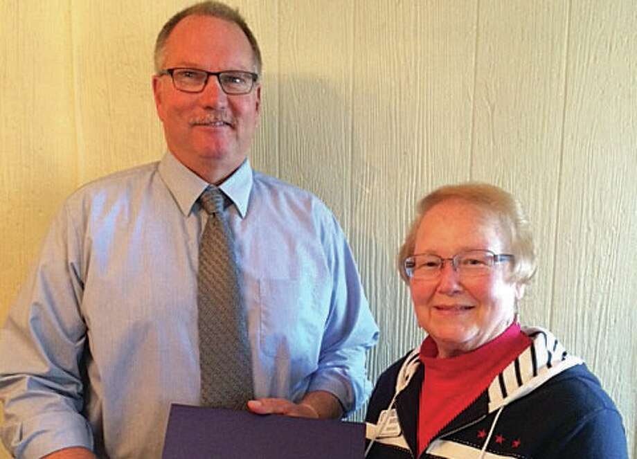 Ron Wruble receives the Paul Harris Award from Harbor Beach Rotary Club President Bette Burton. (Submitted Photo) Photo: Submitted Photo