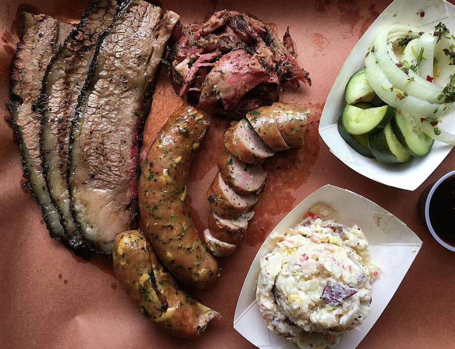 Brisket, pulled pork, pork sausage with Oaxaca cheese and serranos, pickled onions and cucumbers and buttermilk potato salad from 2M Smokehouse. Photo: Mike Sutter /San Antonio Express-News