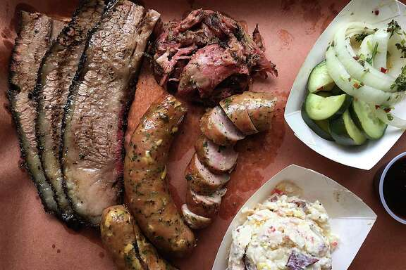 Brisket, pulled pork, pork sausage with Oaxaca cheese and serranos, pickled onions and cucumbers and buttermilk potato salad from 2M Smokehouse.