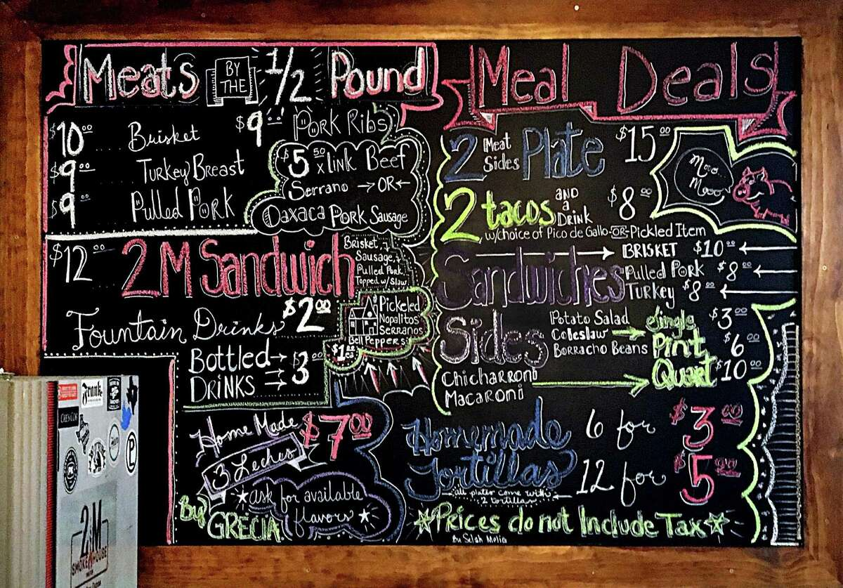 The menu board at 2M Smokehouse was drawn by hand by Selah Melig, the wife of co-owner Joe Melig.