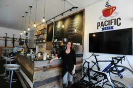 Pacific Cycling President Julie Gabay poses inside the shop's new cafe on High Ridge Rd. in Stamford, Conn. on Thursday, Dec. 1, 2016.