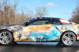 The Chevrolet Camaro that will lead the Wreaths Across America parade from Maine to Arlington National Cemetery is seen at The Matrix office park in Danbury, Conn., where GM has its regional headquarters on Monday, Dec. 5, 2016.