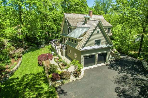 The 12-room custom-built house at 5 Canoe Trail sits on a 1.27-acre level and sloping property on a cul-de-sac in the Tokeneke section of Darien.