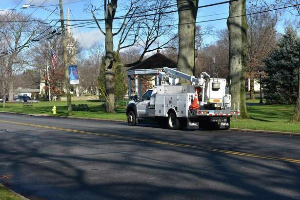 A Frontier Communications field truck pauses during the rounds on Monday, Dec. 5, 2016, adjacent to Norwalk Historic Green in Norwalk, Conn., where the broadband giant is based.