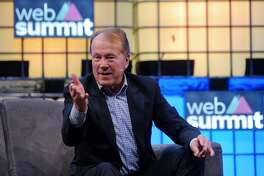 """John Chambers, chairman of Cisco Systems Inc., gestures as he speaks during the Lisbon Web Summit venue in Lisbon, Portugal, on Tuesday, Nov. 8, 2016. The government is wooing the 50,000 tech leaders and their followers descending upon Lisbon this week for a gathering described as the """"Davos for Geeks,"""" hoping they will bolster investment and create much-needed jobs in the southern European country. Photographer: Paulo Duarte/Bloomberg"""