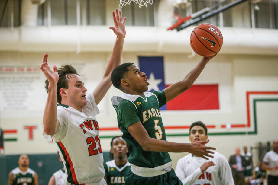Klein Forest's Reggie Miller (5) shoots as The Woodlands' Jack Williams (23) defends during the varsity boys basketball game on Saturday, Nov. 26, 2016, at The Woodlands High School. (Michael Minasi / Chronicle) Photo: Michael Minasi, Staff / © 2016 Houston Chronicle
