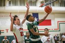 Klein Forest's Reggie Miller (5) shoots as The Woodlands' Jack Williams (23) defends during the varsity boys basketball game on Saturday, Nov. 26, 2016, at The Woodlands High School. (Michael Minasi / Chronicle)