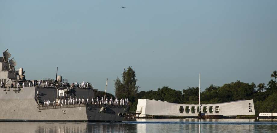 FILE - The U.S.S. Chung-Hoon passes the U.S.S. Arizona Memorial during a memorial service for the 73rd anniversary of the attack on the U.S. naval base at Pearl harbor on the island of Oahu at the Pacific National Monument on December 07, 2014 in Pearl Harbor, Hawaii. Multiple sources are reporting that a shooting has occurred at the Pearl Harbor Naval Shipyard on Wednesday afternoon. Photo: Kent Nishimura/Getty Images