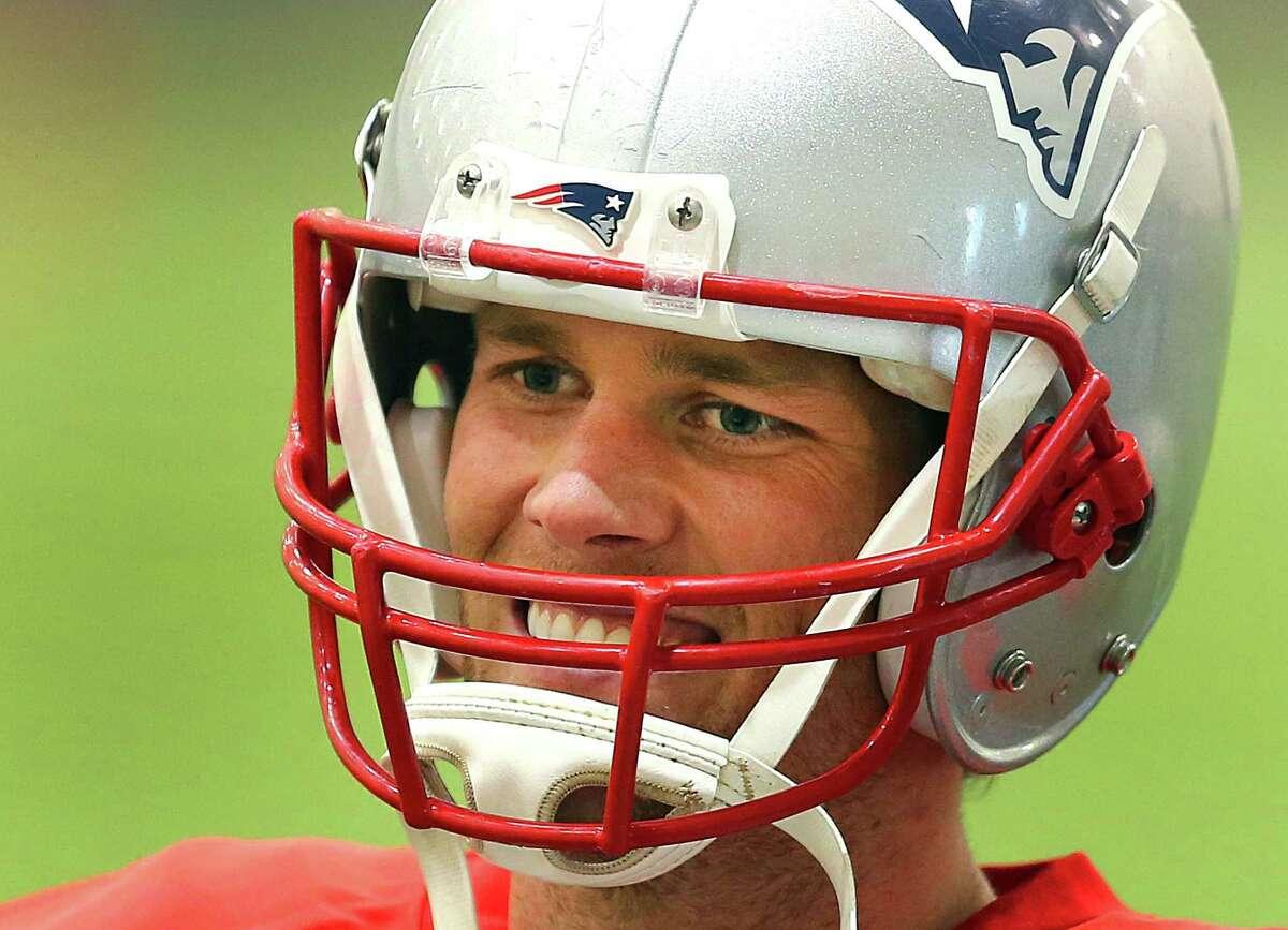 FOXBOROUGH, MA - JANUARY 22: Patriots quarterback Tom Brady smiles during warmups at practice on January 22, 2015. (Photo by John Tlumacki/The Boston Globe via Getty Images)
