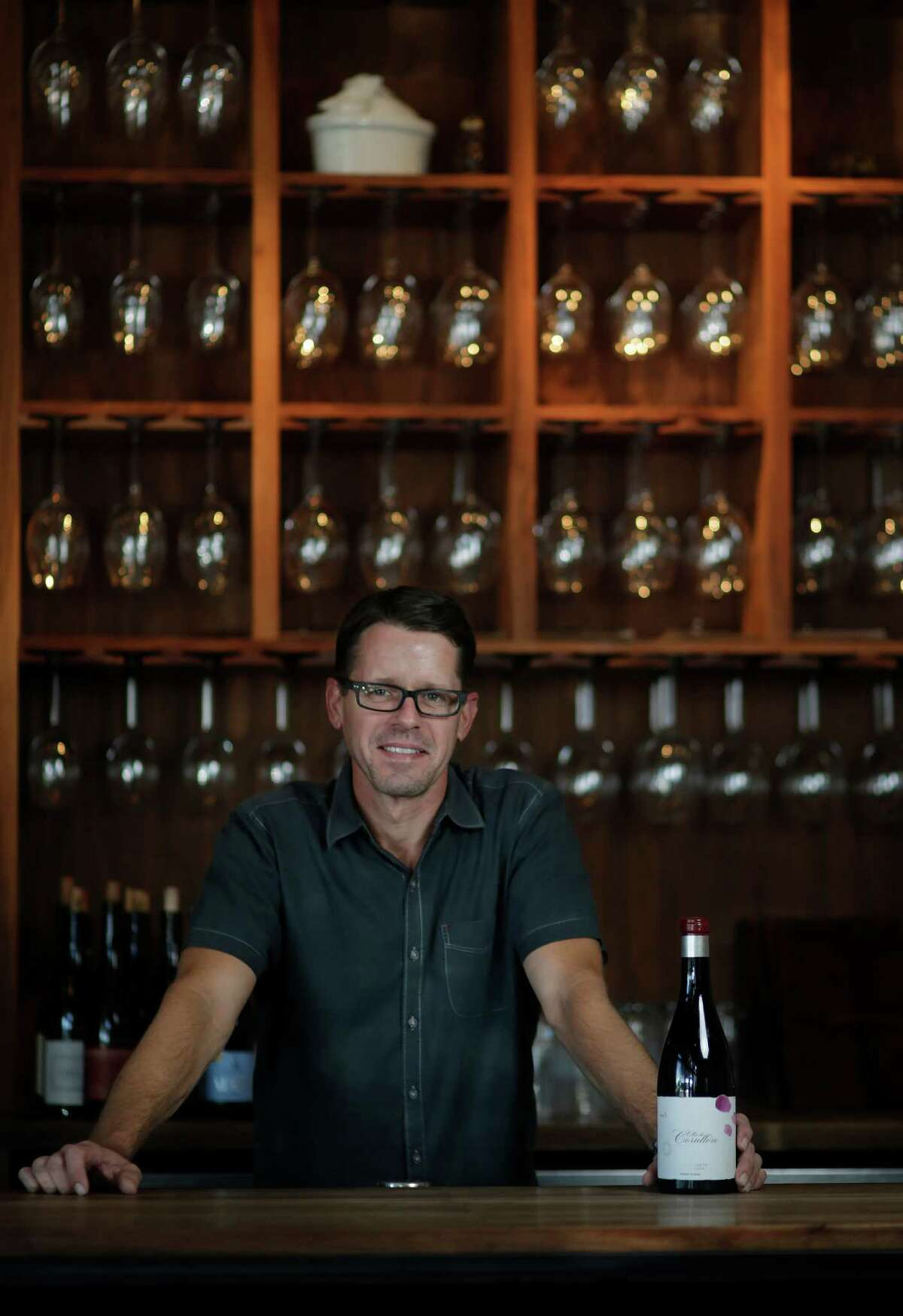 Matthew Pridgen, wine director at Underbelly, with a Mencia from Bierzo in western Spain, Tuesday, Nov. 15, 2016, in Houston. ( Mark Mulligan / Houston Chronicle )