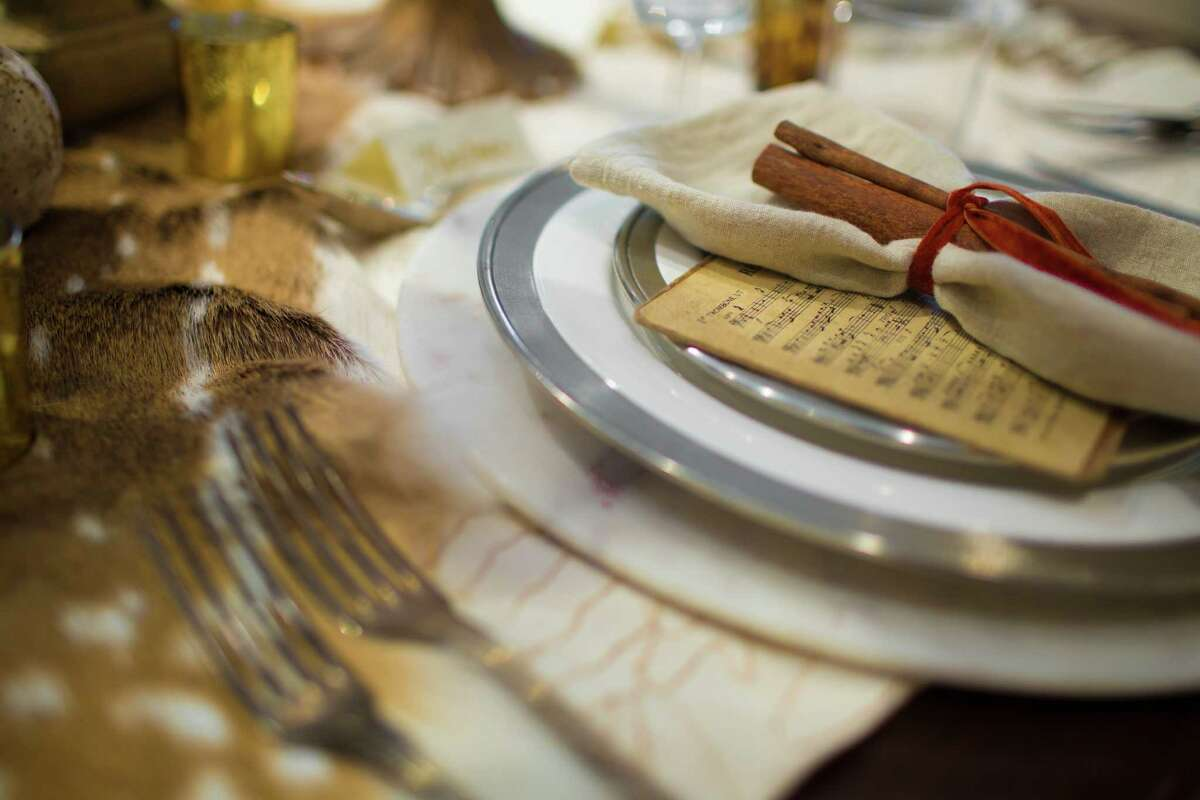 Little touches: On each dinner plate, Leleux used small vintage sheets of music paired with cinnamon sticks and tied them up with vintage silk velvet ribbon.
