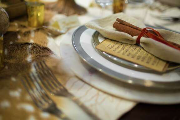 Vintage music sheet as part of the holiday tablescape by interior designer Robert Leleux. The music sheet is used both as decorative and as a party favor. Tuesday, Nov. 29, 2016, in Houston. ( Marie D. De Jesus / Houston Chronicle )