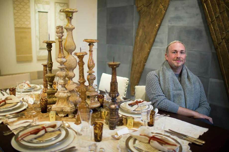 "Interior designer Robert Leleux urges clients to think out of the box when it comes to setting a holiday table. He calls this one, created for the Deck the Tables event at the Houston Design Center, his ""Lion in Winter"" table. Photo: Marie D. De Jesus, Staff / © 2016 Houston Chronicle"