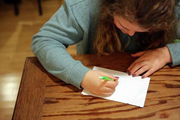 Sixteen-year-old B draws at the kitchen table , Nov. 17, 2016. Two years ago B began showing signs of mental illness, self-harm and suicidal tendencies.  Almost overnight she was hospitalized, diagnosed with Borderline Personality Disorder, and spent much of the following nine months at an adolescent psychiatric facility Nevada. She attempted suicide multiple times since 2014. There are currently no long-term facilities for adolescents in Washington state.  She has just recently been able to begin attending school again.