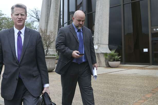 Shannon Smith (right) leaves the John Wood Federal Courthouse Monday December 5, 2016 with his attorney Alex Scharff (left). Smith is facing charges of defrauding investors who invested with the FourWinds Logistics company