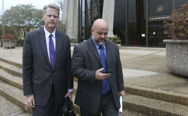 5.Creditors' claims in the bankruptcy top $14 million.In this photo, Shannon Smith, former chief operating officer for FourWinds Logistics (right), leaves court with attorney Alex Scharff. Photo: John Davenport /San Antonio Express-News / ©San Antonio Express-News/John Davenport