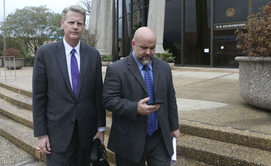 Shannon Smith (right) leaves the John H. Wood Jr U.S. Courthouse in 2016 with his attorney Alex Scharff. Smith pleaded guilty to a felony charge for his role in an alleged scheme to defraud investors of FourWinds Logistics, a now-defunct oil field services company. Photo: Staff File Photo / ©San Antonio Express-News/John Davenport