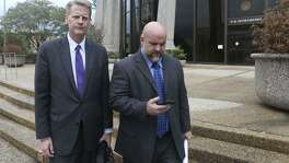 Shannon Smith (right) leaves the John H. Wood Jr U.S. Courthouse in 2016 with his attorney Alex Scharff. Smith pleaded guilty to a felony charge for his role in an alleged scheme to defraud investors of FourWinds Logistics, a now-defunct oil field services company.