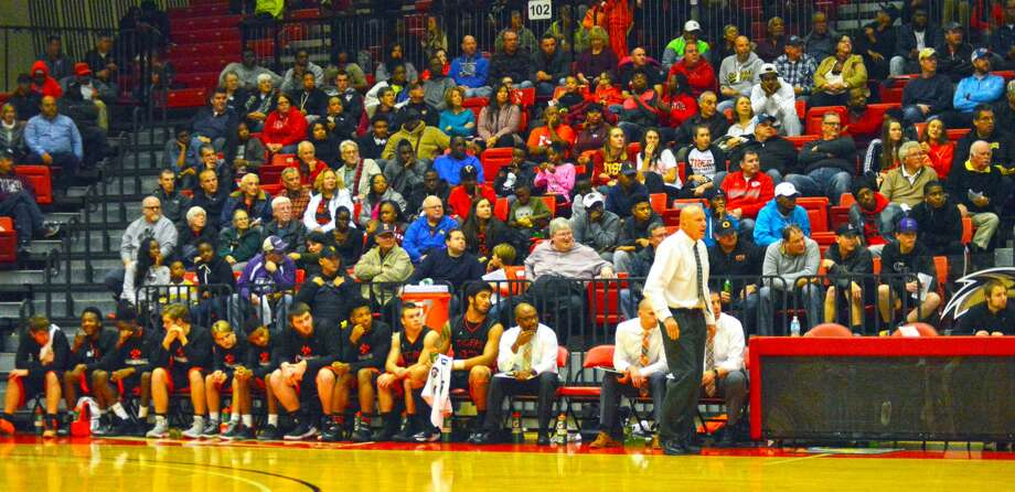 "The Edwardsville boys' basketball watches action during Saturday's game against Belleville West. The game was part of the four-game ""SWC @ the E"" showcase."