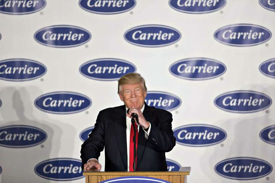 U.S. President-elect Donald Trump smiles during an event at Carrier Corp. in Indianapolis, Indiana, U.S., on Thursday, Dec. 1, 2016. Trump said he called the top executive of United Technologies Corp. shortly after his election and told him not to close a Carrier factory in Indianapolis that became a symbol of the Republican's outsider campaign for the White House. Photographer: Daniel Acker/Bloomberg Photo: Daniel Acker / © 2016 Bloomberg Finance LP
