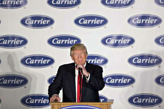 U.S. President-elect Donald Trump smiles during an event at Carrier Corp. in Indianapolis, Indiana, U.S., on Thursday, Dec. 1, 2016. Trump said he called the top executive of United Technologies Corp. shortly after his election and told him not to close a Carrier factory in Indianapolis that became a symbol of the Republican's outsider campaign for the White House. Photographer: Daniel Acker/Bloomberg