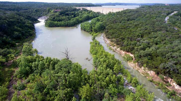 Water flowing over the Medina Lake spillway, left, May 31, 2016 and fills the area below the dam that becomes Diversion Lake as seen in an aerial image taken with a remote control quadcopter. (Photo: William Luther / San Antonio Express-News)