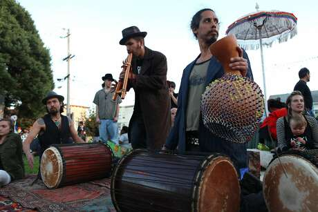 Lesar Garcia, Derick Ion and Darren play music at the Day of the Dead celebration at Garfield Park in San Francisco Calif., on November 2, 2011.