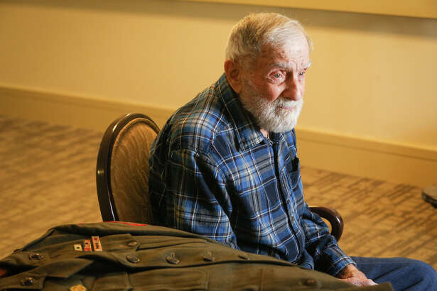 World War II veteran Fritz Weinhofer, 93, recalls some of his experiences as a Marine in the Pacific campaigns on Monday, Dec. 5, 2016, at The Village at the Waterway in The Woodlands.