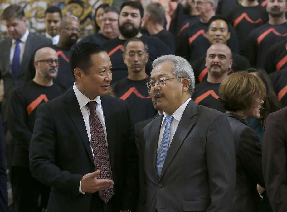Mayor Ed Lee (right) and Public Defender Jeff Adachi agree to resist deportations, but how will that resistance be funded? Photo: Jeff Chiu, Associated Press