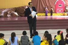 IBC Bank Vice President Hector Equihua is pictured at Dovalina Elementary School.