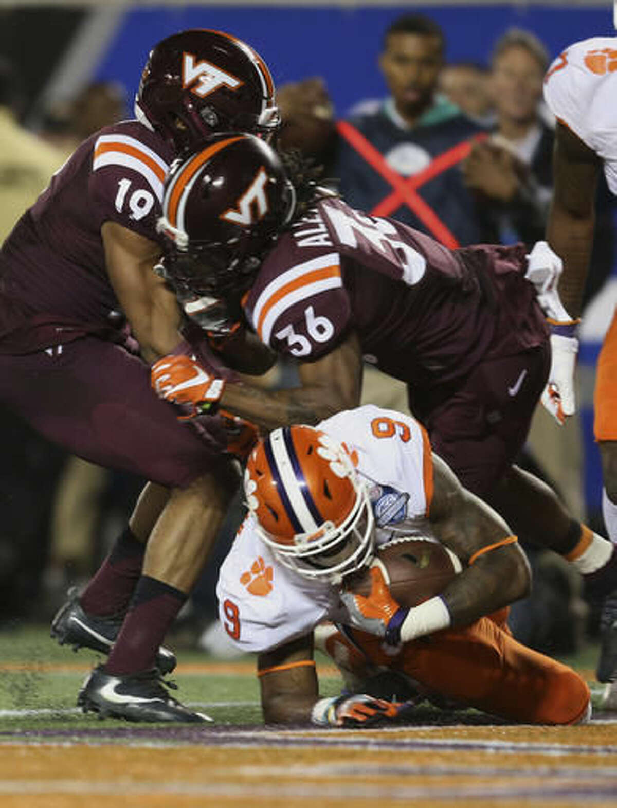 Clemson running back Wayne Gallman (9) scores a touchdown as Virginia Tech cornerback Adonis Alexander (36) and defensive back Chuck Clark (19) are late with the tackle, during the second half of the Atlantic Coast Conference championship NCAA college football game, Saturday, Dec. 3, 2016, in Orlando, Fla. (AP Photo/Willie J. Allen Jr.)