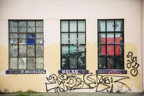 "The windows of a warehouse known as "" The Death Trap"" are seen at 1190 28th Street in Oakland, in Oakland, California, on Monday, Dec. 5, 2016."