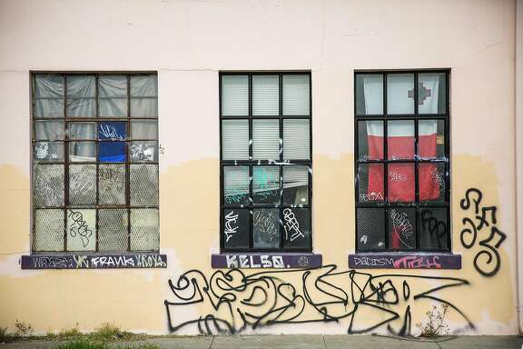 """The windows of a warehouse known as """" The Death Trap"""" are seen at 1190 28th Street in Oakland, in Oakland, California, on Monday, Dec. 5, 2016."""