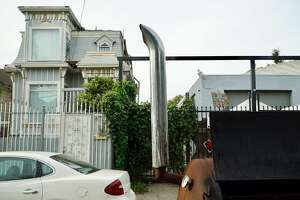 """Luke Woll's homemade grill called the """"Flavor Beast"""" is seen in West Oakland near the location of a party where he recently cooked."""