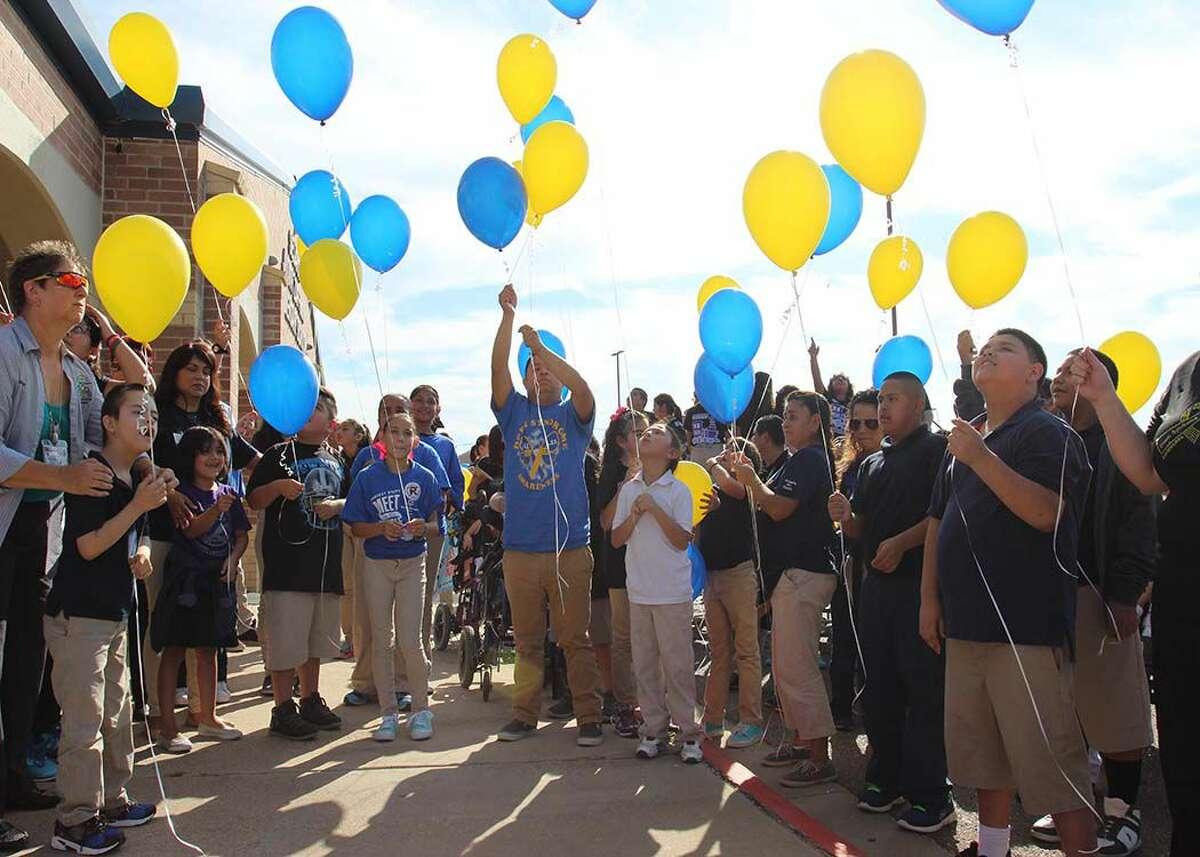 Special education students from United ISD and staff celebrate Down Syndrome Awareness Month at Zaffirini Elementary with a balloon release.