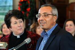 Ahmed Ebrahim, director of the Bridgeport Islamic Community Center, seen here with Rev. Sara Smith, Senior Minister United Congregational Church, speaks at a press conference at the church in Bridgeport, Conn. Dec. 5, 2016. It was announced that the United Congregational Church building will be sold to the Islamic Community Center early next year.